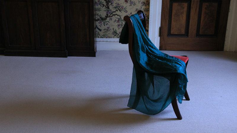 Installation by Azadeh Fatehrad - fabric draped over a chair