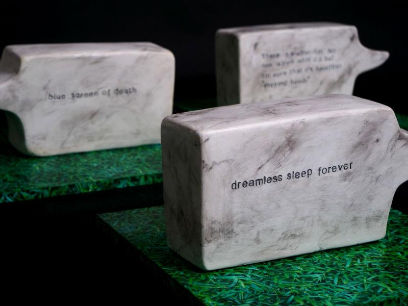 Sculptures cast in plaster by D'arcy Darilmaz, entitled Grave Remarks