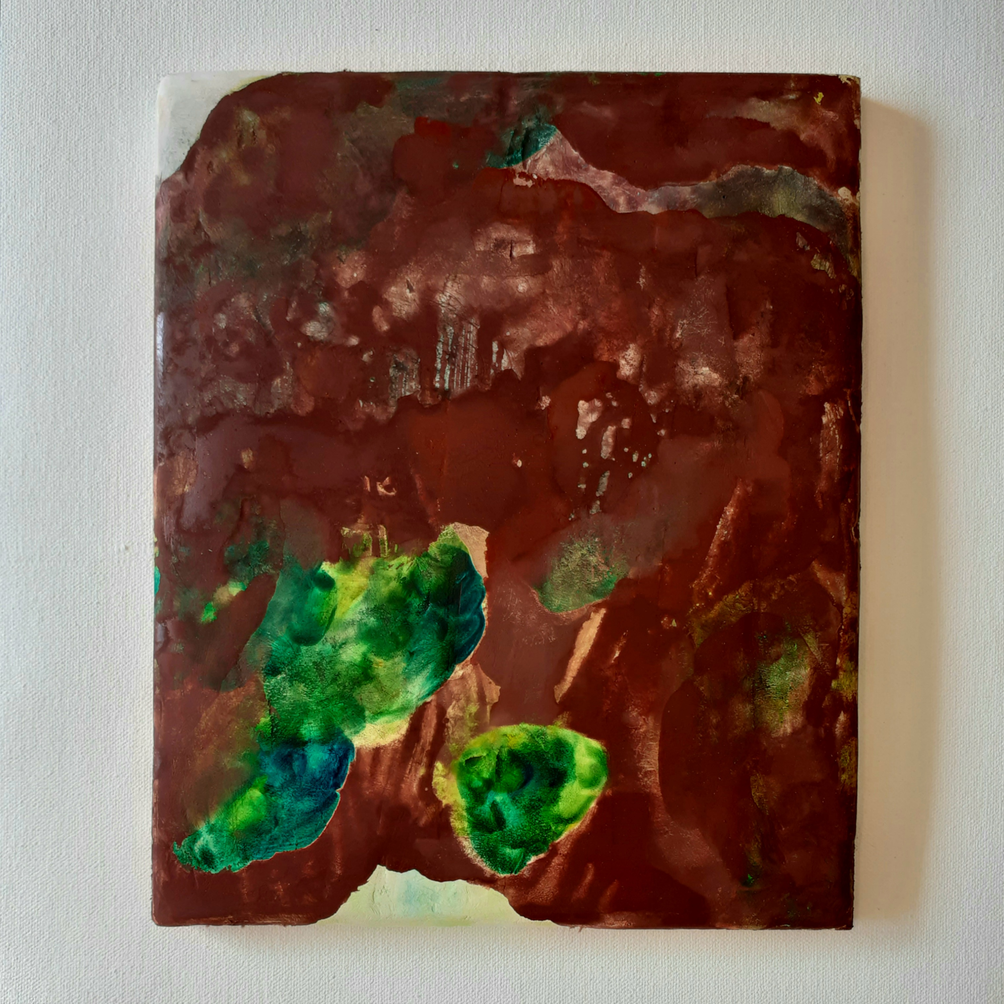 Painting by Marielle Hehir featuring shades of red and green depicting pieces of moss body.