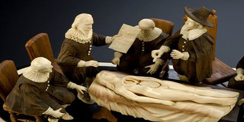 Wood and ivory figure group representing an anatomical demonstration by Nicholas Tulp, based on Rembrandt's painting: The Anatomy Lesson. (Detail view of patient and figures. Graduated black background. Science Museum. London, CCBY)
