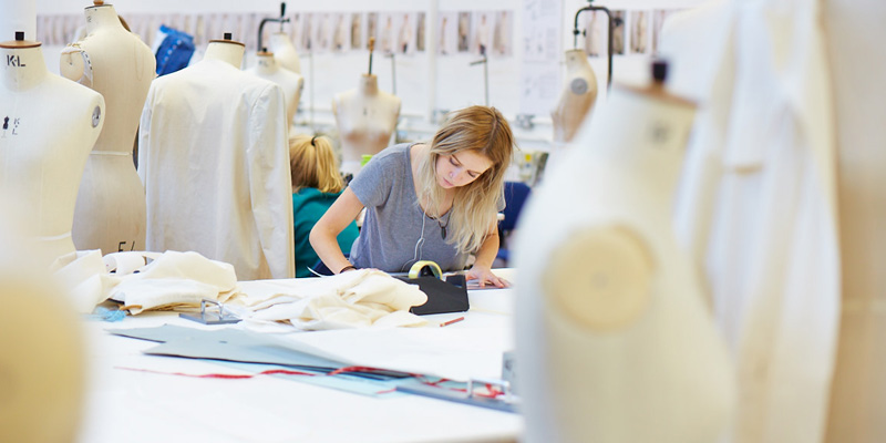 Student in a studio with manikins