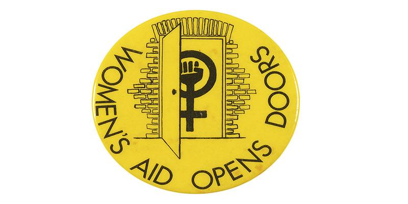 Image of Women's Aid Opens Doors logo. Circular yellow background with contrasting clenched fist merged with Venus symbol entering doorway.