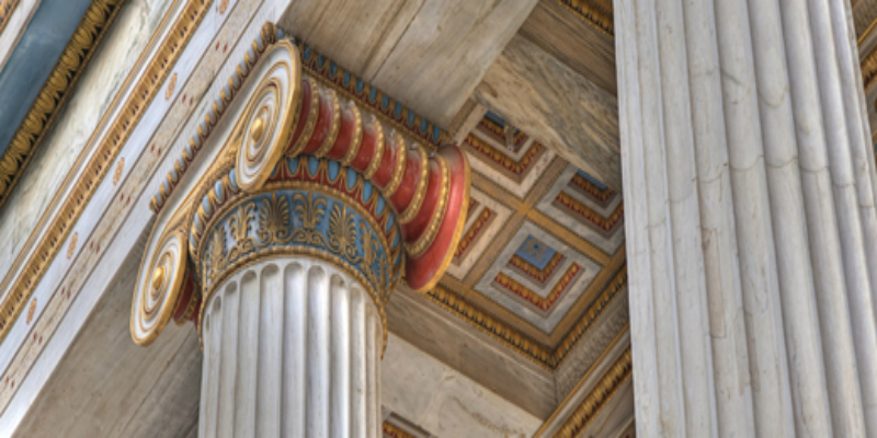 A photo of a decorative pillar in the ancient Greek style.