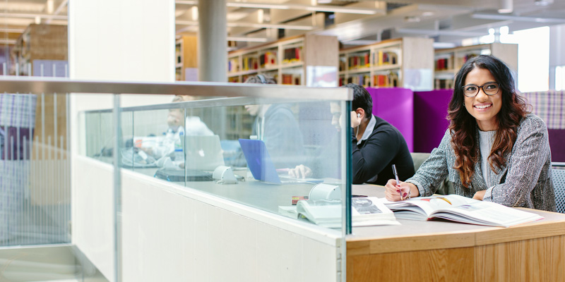 Student at a library desk.