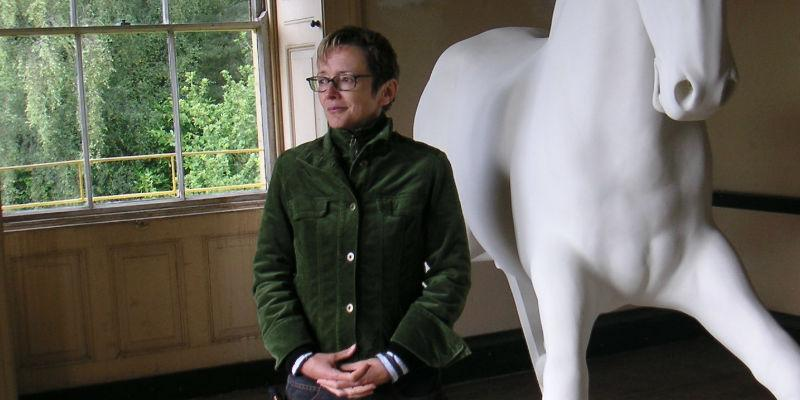 Image of Beryl Graham next to sculture