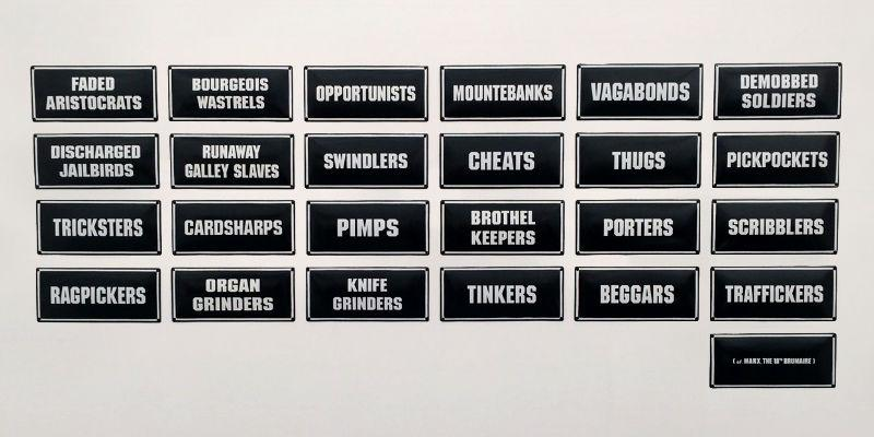 Carmela Gross, EXTRAS, 25 enamelled metal signs (each 20cm x 45cm). Image courtesy of the artist.