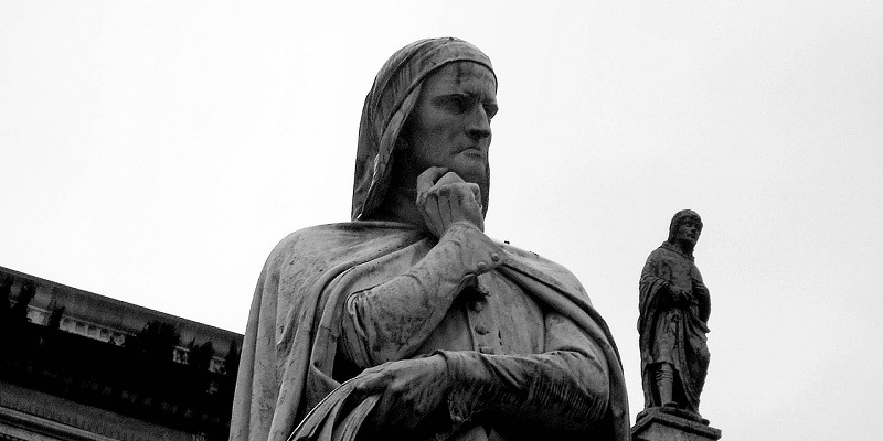 Black and white image of Dante statue in Verona, Italy.