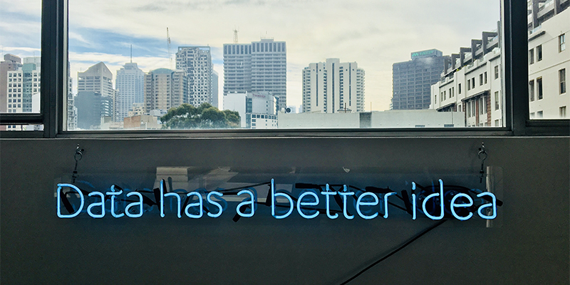 Graphic of window view to city scape and words 'date has a better idea' in blue font.