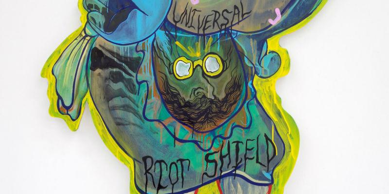 Detail from an enamel on wood artwork by Hardeep Pandhal entitled Universal Riot Shield.