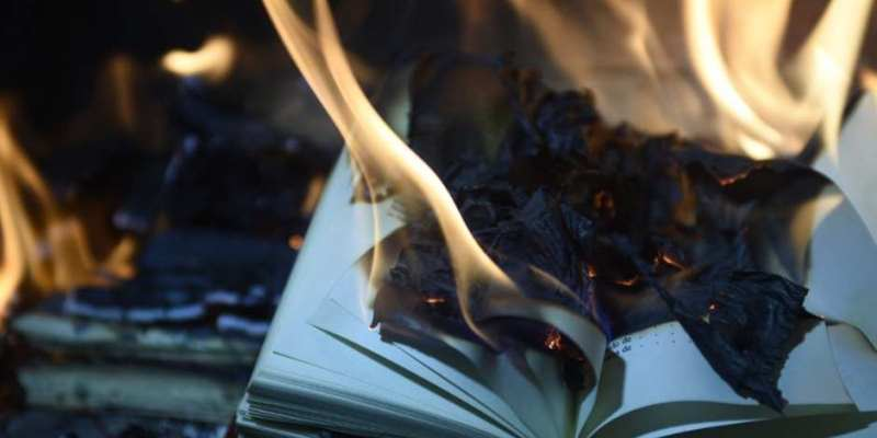 book in flames