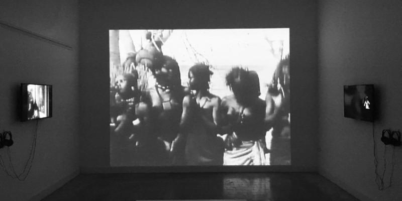 Black and white photo of a video installation entitled Installation shot: No Dance, No Palaver (2017–2018). In '[POST] Colonial Bodies I', MUNTREF, Buenos Aires, 2019.