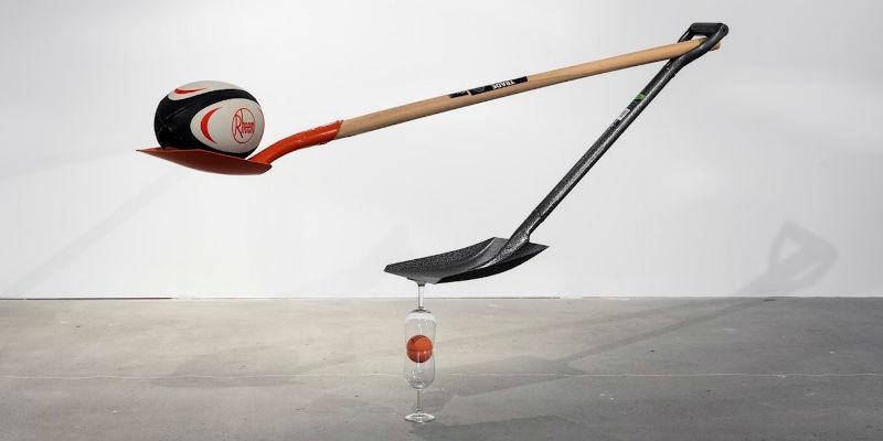Untitled installation using rugby ball, shovels, hi-bounce ball, wine glasses by Matt Calderwood