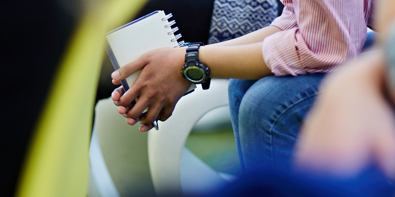Notebook in the hands of a student.