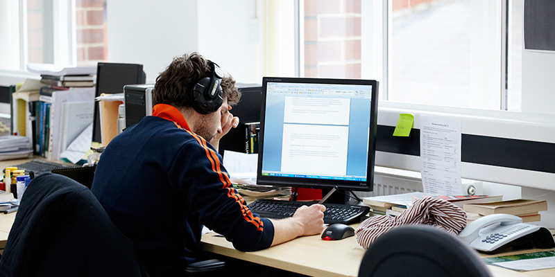 Student at computer desk