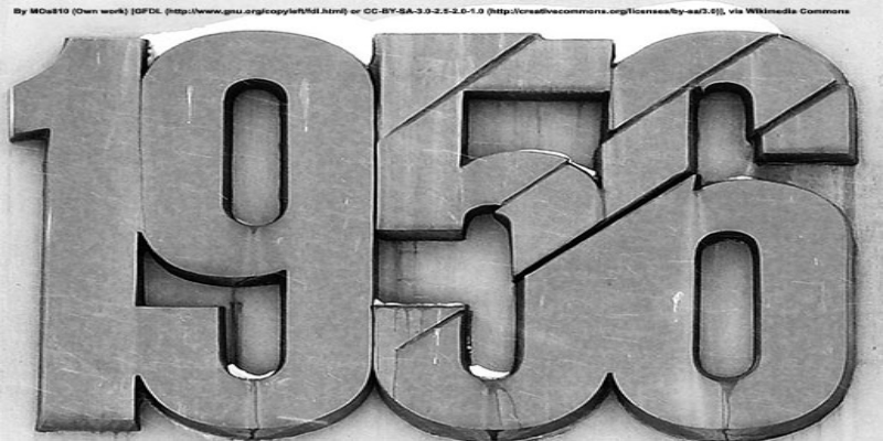 A grey photo of numbers to represent the year 1956.