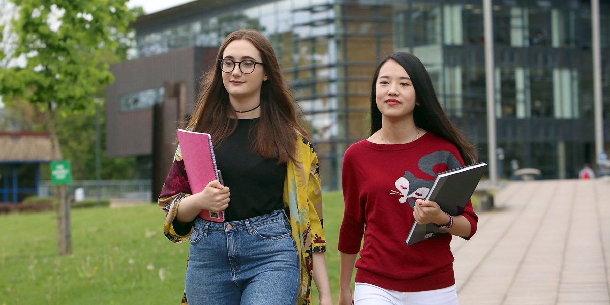 Students walking across University of Leeds campus