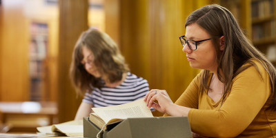 Students looking at archives