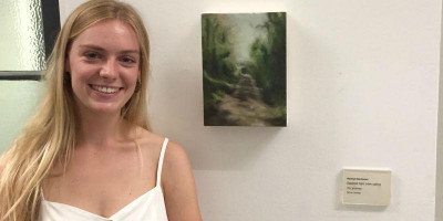 Hannah buchanan with her oil painting on canvas Dappled light interrupting my journey, at the Cut the Mustard BA Fine Art Degree Show 2019