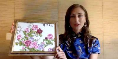 Rebecca Mingotti Landriani holds her Chinese style painting of flowers
