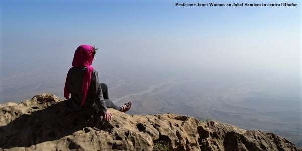 Professor Janet Watson sits on a hillside overlooking Dhofar