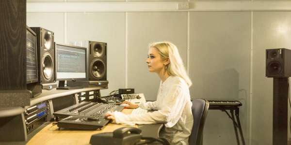 Student in a music editing suite