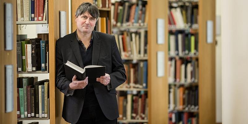 Professor Simon Armitage in University library